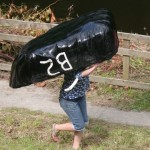 Moving coracle on land